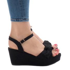Sandales compensées noires avec noeud F055