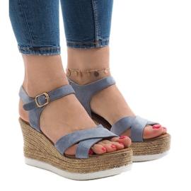Sandales bleues sur talon compensé XL104