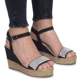 Sandales noires sur un talon compensé Diamond Shine délicat