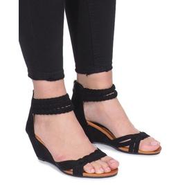 Sandales noires sur une délicate semelle Desun